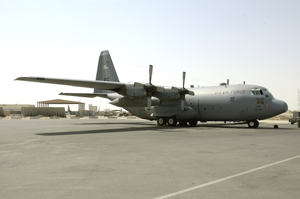Aircraft 63-7865, a C-130 Hercules deployed from Ramstein Air Base, Germany, sits on the flightline at a forward operating base in Southwest Asia. The aircraft features a plaque telling its story of being a Purple Heart recipient. (U.S. Air Force photo/Staff Sgt. Ryan Hansen)
