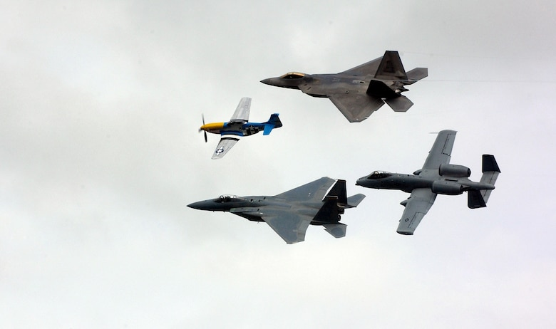 ELMENDORF AIR FORCE BASE, Alaska -- A Heritage Flight with a P-51 Mustang, F-15, F-22 and A-10 fly over the crowd during Arctic Thunder here Aug. 12. The event drew nearly 136,000 for Elmendorf's 60th open house and air show. (U.S. Air Force photo by Airman Jonathan Steffen)