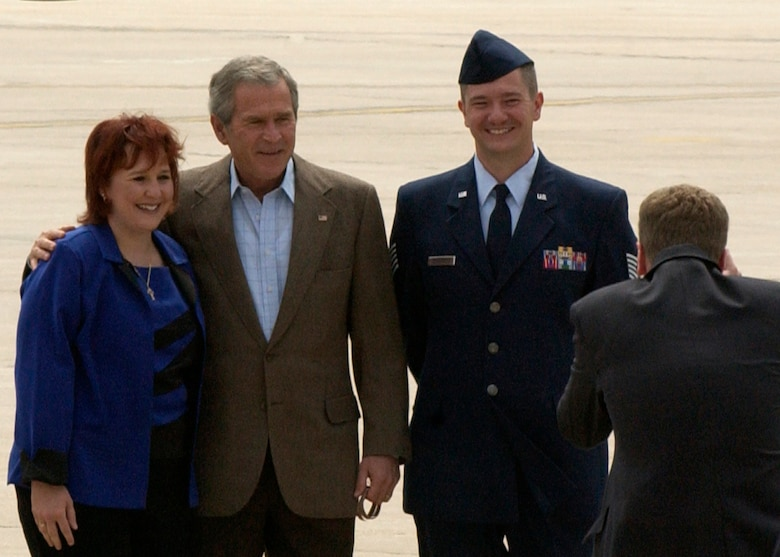 President Bush takes a moment for photographs with Tech. Sgt. Brian Webster and his wife Theresa Webster after presenting the Presidential Service Award to the sergeant. (U.S. Air Force photo by Staff Sgt. Chenzira Mallory)