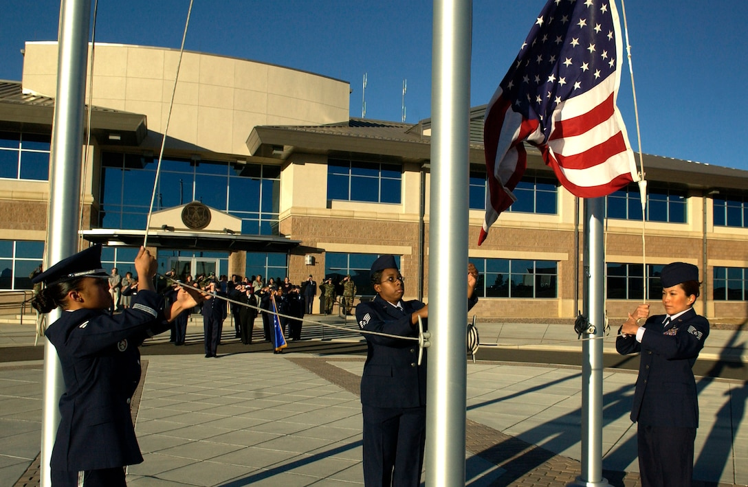 BUCKLEY AIR FORCE BASE, Colo. -- From Left to right: Airman 1st Class Karen Nedal, Staff Sgt. Aleisha Jordan, and Tech. Sgt. Karen Figueroa, raise the colors during revielle kicking off Women's History month here March 1, 2006 (U.S. Air Force photo by Staff Sergeant Chenzira Mallory)