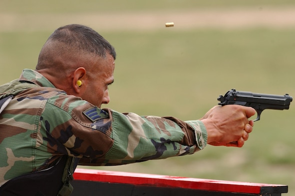Senior Airman Romy Villescas of the 460th Security Forces Squadron, Buckley Air Force Base, Colo., fires a 9-mm pistol during the marksmanship portion of Guradian Challenge 2006.