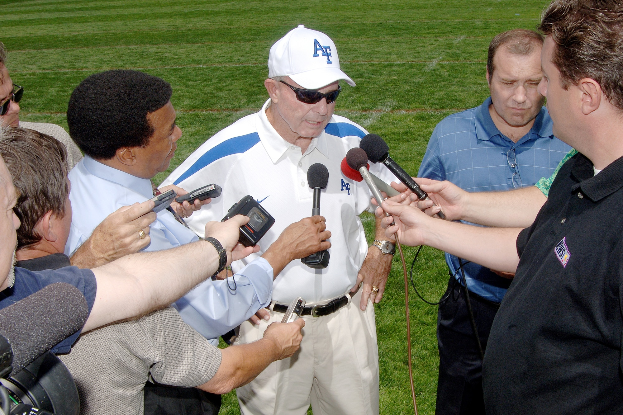 Air Force head football coach Fisher DeBerry addresses media day reporters at the U.S. Air Force Academy following his team's first practice of the year. Despite two straight losing seasons, DeBerry enters his 23rd campaign patrolling the Falcon sidelines as the all-time winningest coach in service academy history with a 165-101-1 overall record. (U.S. Air Force photo/Danny Meyer)