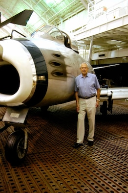 DAYTON, Ohio - Lt. Col. Bruce Hinton stands beside the North American F-86A Sabre in the Korean War Gallery at the National Museum of the U.S. Air Force. The museum's F-86 is is marked as the 4th Fighter Group F-86A flown by Lt. Col. Bruce Hinton on Dec. 17, 1950, when he became the first F-86 pilot to shoot down a MiG. (U.S. Air Force photo)
