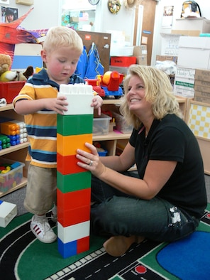 MOODY AIR FORCE BASE, Ga. -- Tammy Turnmeyer, fitness center manager, helps her son Dane build with blocks at the Child Development Center Wednesday. The 347th Medical Group raised $1,051.60, mostly from spare change,during a recent fundraiser to help the Turnmeyer family with Dane's medical expenses. Dane, 3, suffers from a hypoplastic left heart, meaning the left side of his heart doesn't function. (U.S. Air Force photo by Airman 1st Class Eric Schloeffel)