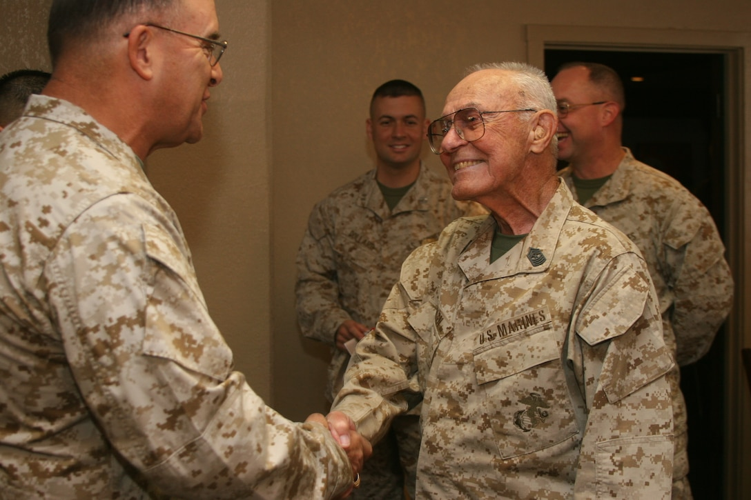 Sgt. Maj. Ray Wilburn, who retired from the Combat Center in 1971, returned to active duty for one day at the age of 87 for the Combat Center?s birthday celebration Aug. 18. He was issued a set of current camouflage utilities for the occasion.