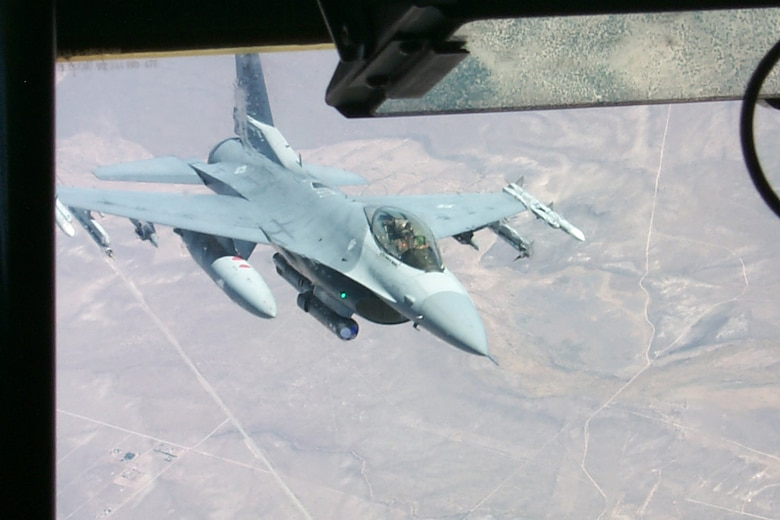 An Iowa Air National Guard F-16 pulls away from a KC-135 tanker during a Red Flag exercise Aug. 17. Red Flag brings together up to 110 aircraft and more than 2,500 Airmen from around the world, including Allied air forces, to sharpen large-force combat skills. The current Red Flag exercise at Nellis AFB ends Sept. 2. (U.S. Air Force photo/Mike Estrada)