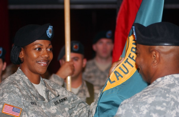 Lt. Col. Mechelle B. Hale, U.S. Army Garrison Kaiserslautern commander, accepts the Garrison Organizational Colors from Col. Willie E. Gaddis, USAG Heidelberg commander, in a change-of-command ceremony Aug. 10 at the Armstrong Community Club on Vogelweh Housing in Kaiserslautern.