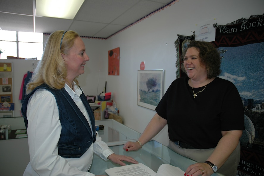 Mrs. Meredith Muhs, above left, stops in to visit and share a laugh with the new manager at the Buckley Thrift Shop, Mrs. Diane Herrlman.  Mrs. Muhs was named Buckley Air Force Base Spouse of the Year, then Air Force Space Command Spouse of the Year, and will now compete at the Air Force level for the same honor. (U.S. Air Force photo by Mrs. Barbara Atwell)