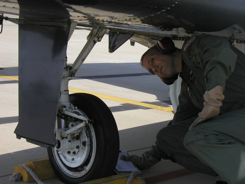 Instructor Pilot 1st Lt. Philip McClure performs a pre-flight inspection prior to his training sortie. (U.S. Air Force photo by Capt. Tony Wickman)