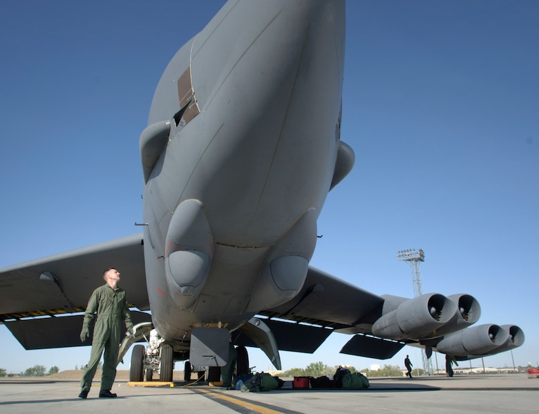 Capt. Patrick Hook performs a walk-around inspection of a B-52 Stratofortress bomber Aug. 22 at Minot Air Force Base, N.D. Captain Hook, from Muskegon, Mich., is with the 23rd Bomb Squadron. (U.S. Air Force photo/Master Sgt. Lance Cheung)