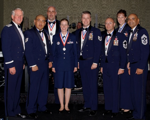Gen. William R. Looney, Air Education and Training Command commander, and Chief Master Sgt. Rodney Ellison, AETC command chief master sergeant, stand with the 2005 AETC Outstanding Airmen of the Year.  The winners were announced during a banquet in San Antonio April 7, honoring nominees and winners.  (U.S. Air Force photo by Melissa Peterson)