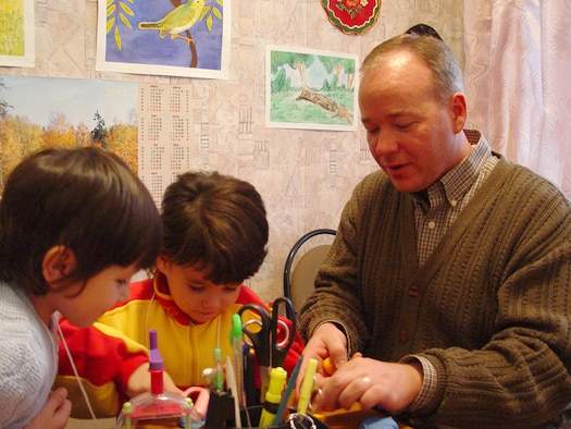 Chaplain (Capt.) Kenneth Fisher works on arts and crafts with Kristina (left) and Olga at the orphanage in Ryazan, Russia. (Courtesy Photo)