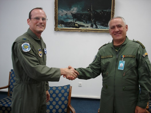 Col. Rich Johnston, KMC and 86th Airlift Wing commander, gives a wing coin to Romanian Lt. General Gheorghe Catrina, Romanian Air Force chief of staff, during a visit to Mihail Kogalniceanu Air Base Monday. Photo by Capt. Erin Dorrance.