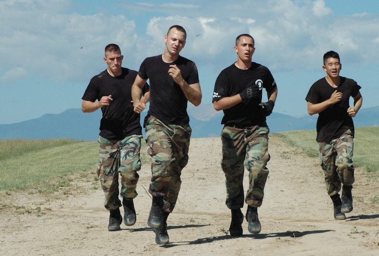 MINOT AIR FORCE BASE, N.D. -- (from left to right) Senior Airman James Rowin, Staff Sgt. Jesse Guerra, Senior Airman Will Benson and Airman 1st Class Tom Donahue, all from the 91st Security Forces Group, run as they close in on the finish line on the obstacle course at Shriever Air Force Base, Colo. on the last day of competition during Guardian Challenge. (U.S. Air Force photo by Senior Airman Danny Monahan)