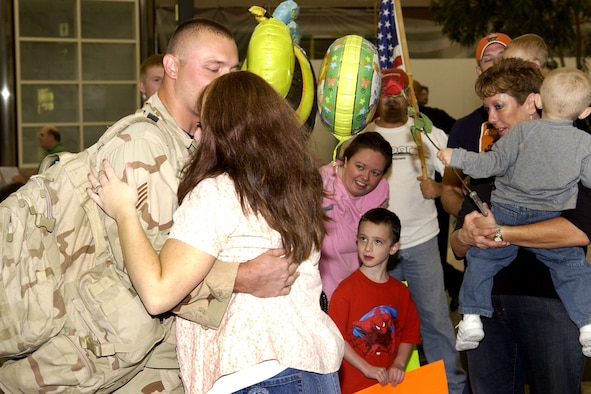 Staff Sgt. Benjamin Harting, 460th Security Forces Squadron, is welcomed home by his wife at Denver International Airport Aug. 19.  Twelve other security forces members also returned home from their six-month deployment to Iraq.  (U.S. Air Force photo by Senior Airman Steven Czyz)
