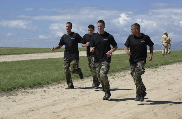 Tech. Sgt. Travis Silvers, from the 137th Space Warning Squadron, Senior Airman Christopher Malloy and Senior Airman Matthew Masciorini, from the 460th Security Forces Squadron, and Senior Airman Romy Vazquez, from the 137th SWS, run as the 460th SFS team in the Guardian Challenge 2006. (U.S. Air Force photo by Airman 1st Class Michelle Cross )