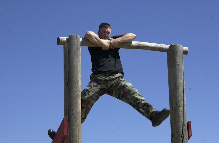Senior Airman Mathew Masciorini, from the 460th Security Forces Squadron Guardian Challenge team, completes the obstacle course at the Guardian Challenge. (U.S. Air Force photo by Airman 1st Class Michelle Cross )