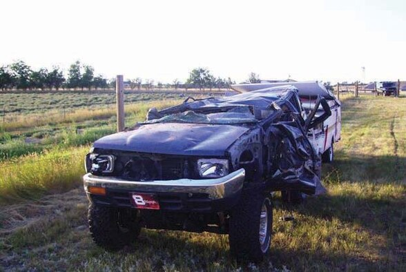 MINOT AIR FORCE BASE N.D. -- Staff Sgt. Jennifer Farley, 5th Munitions Squadron,  was driving this sport utility vehicle  when a vehicle mishap caused it to roll about two-and-a-half times before resting upside-down. The mishap resulted in only injuries, but according to officials, it could have been fatal if seat belts not been used. (courtesy photo)