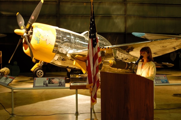 DAYTON, Ohio (8/24/06) -- Kelly Rooker speaks during the P-47D unveiling at the National Museum of the United States Air Force. The restored P-47D was marked by the museum's restoration staff to represent the aircraft flown by her father, Col. Joseph Laughlin, commander of the 362nd Fighter Group, 9th Air Force, during combat operations in Europe in early 1945. (U.S. Air Force photo by Jeff Fisher)