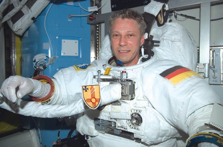 Thomas Reiter displays his German air force patch while aboard the Space Shuttle. He is currently on-board the International Space Station.