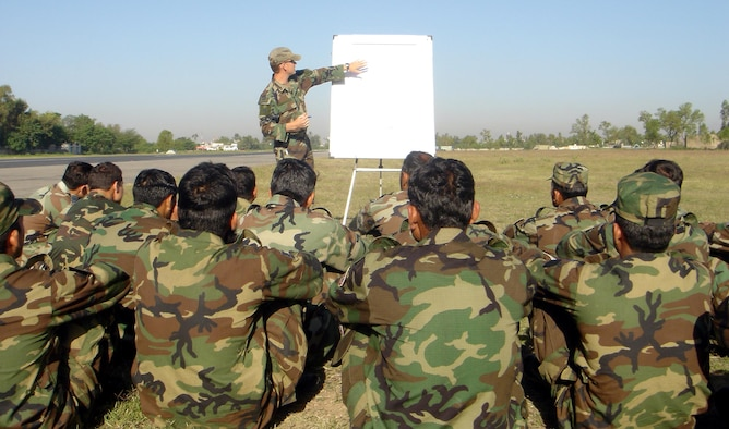 A 6th Special Operations Squadron combat aviation advisor instructs a class on battle field drills in a host nation.  CAAs from the 6th SOS assist aviation forces worldwide. (Courtesy Photograph)
