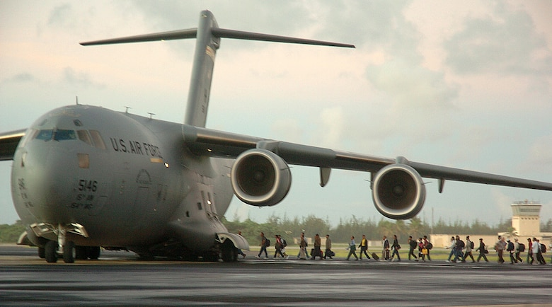 The second wave of 188 Wake Island evacuees board a C-17 Globemaster III, from Hickam Air Force Base, Monday prior to Super Typhoon Ioke reaching the tiny U.S. territory. Ioke is expected to hit the island around 8.p.m. EDT Wednesday. (U.S. Air Force photo/Tech. Sgt. Andrew Leonhard)