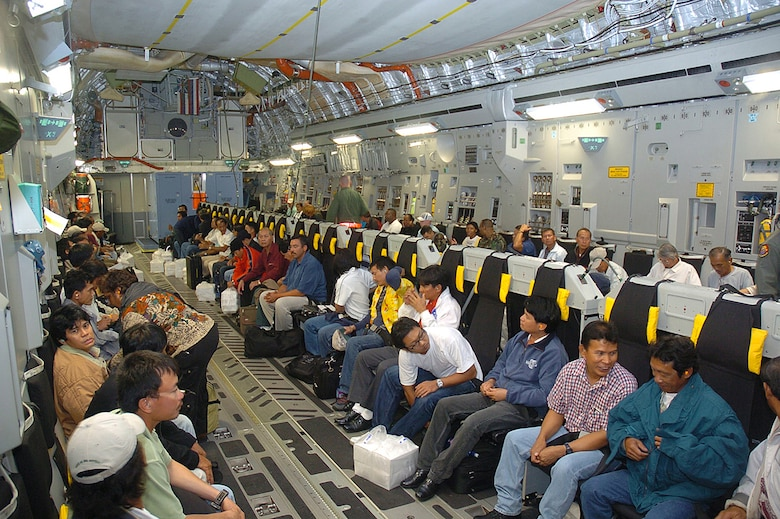 Some of the 188 Wake Island evacuees take their seats on a C-17 Globemaster III, from Hickam Air Force Base, Monday prior to Super Typhoon Ioke reaching the tiny U.S. territory. Ioke is expected to hit the island around 8.p.m. EDT Wednesday. (U.S. Air Force photo/Tech. Sgt. Andrew Leonhard)