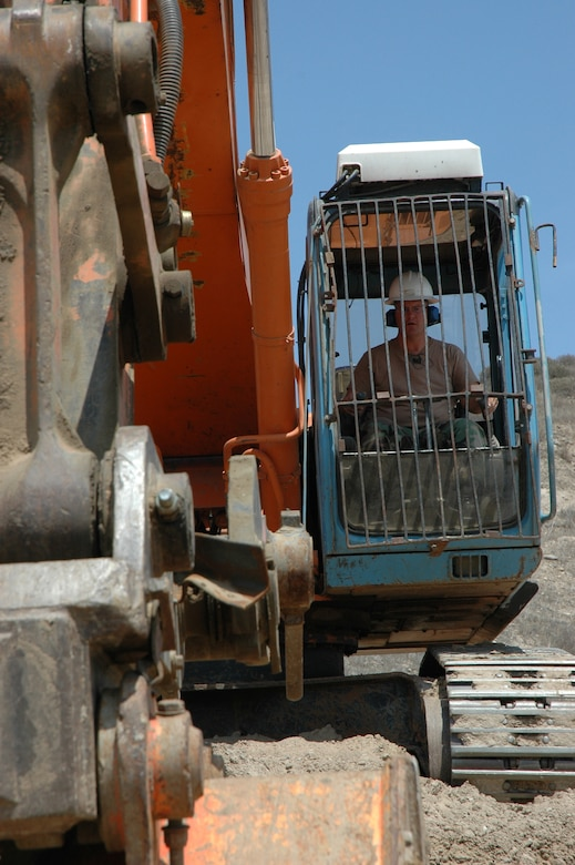 Heavy Equipment Operator Tech. Sgt. Kevin Maier, California Air National Guard civil engineer,  works an excavator at the road raising job site.  (U.S. Air Force photo by Lt. Col. Mark Moritz, 163 ARW)