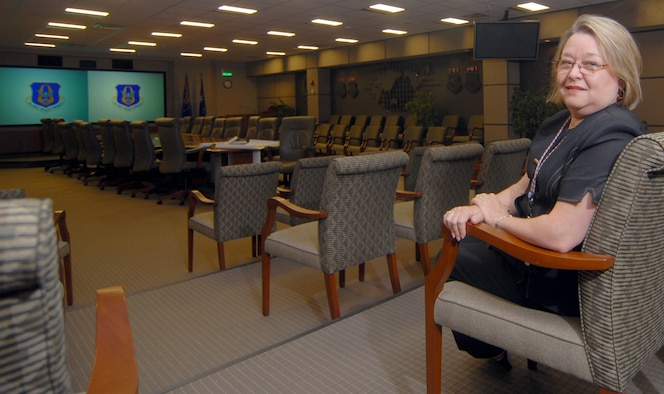 Pat McCutchin sits inside the Headquarters Air Force Reserve Command conference center at Robins Air Force Base, Ga. As the command's senior interior designer, Ms. McCutchin has overseen the comprehensive interior design on hundreds of new AFRC construction and renovation projects, including the conference center. (U.S. Air Force photo by Master Sgt. Chance C. Babin)