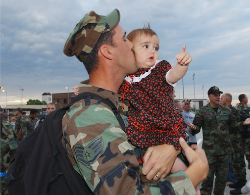 Whiteman Air Force Base, MO - Staff Sergeant Christopher Carpenter, 509th Bomb Wing, 509th Communications Squadron holds his 1 ½ year old daughter Cheyenne upon his return from Andersen AFB, Guam on 29 August 2006.  Members of the 509th Bomb Wing deployed for 120 days in support of Operation Ocean Fury.  (US Air Force photo by TSgt Joan D. Anderson-Brown)