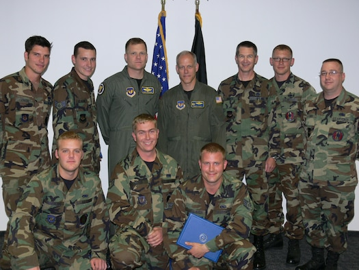 Lt. Col. David Uselman, 86th Operations Group deputy commander (back row, third from left), Col. Glen Apgar, 86th Airlift Wing vice commander (back row, center) and Col. Robert Burnett, 86th Maintenance Group commander (back row, third from right), congratulated seven Dedicated Crew Chiefs from the 86th Aircraft Maintenance Squadron after the DCC's took their oath. Photo by Monica Mendoza.