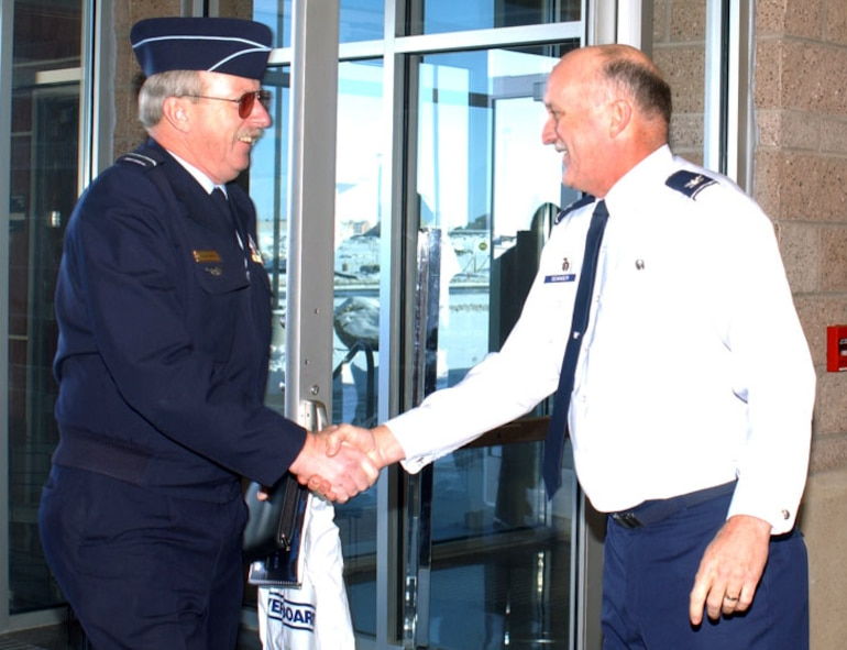 Col. Danny Seanger, 460th Space Wing vice commander, meets Air Vice Marshal Alfred Quaife, Air Commander, Australia, Nov. 30 at the Mission Control Station. Air Vice Marshal Quaife paid a visit to some of the members of the Royal Australian Air Force who are stationed here as part of his visit to Buckley to gain a better understanding of what his troops bring to the space mission.
