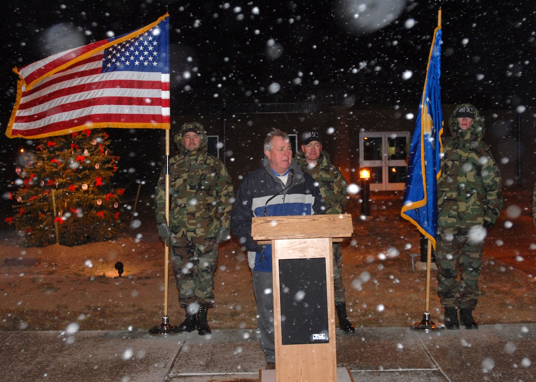 Mr. Craig Mansfield, father of the 460th Space Communications Squadron's Senior Airman Chris Mansfield, warns the 460th SCS tree lighting ceremony audience members of the dangers of drinking and driving Nov. 29. Mr. Mansfield lost his son to a drunk driver about two years ago. The SCS lights the tree in honor of Airman Mansfield. (U.S. Air Force photo by Airman 1st Class Michelle Cross)