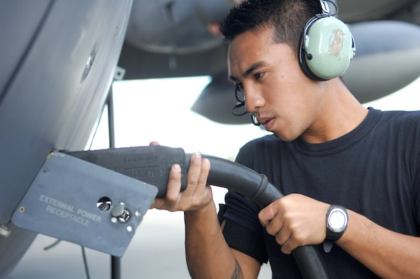 Airman 1st Class Philip Yago connects a plug to the external power receptacle of an HC-130P Nov. 28 at Moody Air Force Base, Ga. The 723rd Maintenance Group recently conducted a two-day meeting to find efficiencies and cut waste from the C-130 Hercules isochronal inspection process. Airman Yago is a 723rd Aircraft Maintenance Squadron crew chief. (U.S. Air Force photo/Airman 1st Class Schelli Jones)