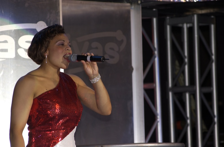 Staff Sgt. Erika Placencia, from San Antonio, sings during a Tops in Blue 2005-2006 performance. She is the 460th Space Communications Squadron's star performer. (Courtesy photo)