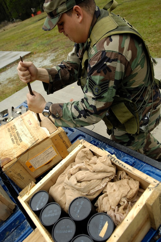 Staff Sgt. Fernando Olivas, 437th Security Forces Squadron, loads up on ground burst simulators for expeditionary combat skills training at Charleston Air Force Base, S.C., Nov. 16, 2006. (U.S. Air Force photo by Staff Sgt. JoAnn S. Makinano)(Released)