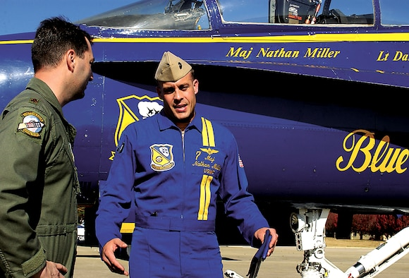 SEYMOUR JOHNSON AIR FORCE BASE, N.C. - Major Jeff D?Ambra, 336th Fighter Squadron Liaison for Blue Angels, welcomes #7 Navy Maj. Nathan Miller, Air Show narrator for the Aerial Demonstration Team Blue Angels, during a site visit of the base. The site visit is one of the final steps in the decision-making process for the Blue Angels choosing which bases to add to the team?s 2007 air show calendar. Major Miller and team?s event coordinator #8 Navy Lt. Dan McShane spent the day with air show committee members gathering information and visiting base facilities. The official decision will be announced following the International Council of Air Shows conference next week. Airshows provide an opportunity for the public to get an up-close look at America?s air power.  (U.S. Air Force photo by Staff Sgt. Les Waters)
