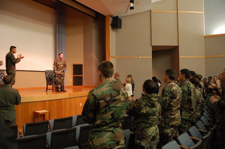 Staff Sgt. Israel Del Toro, a Tactical Air Control Party Airman who was severely injured in Afghanistan in Dec. 2005, receives a standing ovation after speaking to a group of Laughlin members about his experiences.