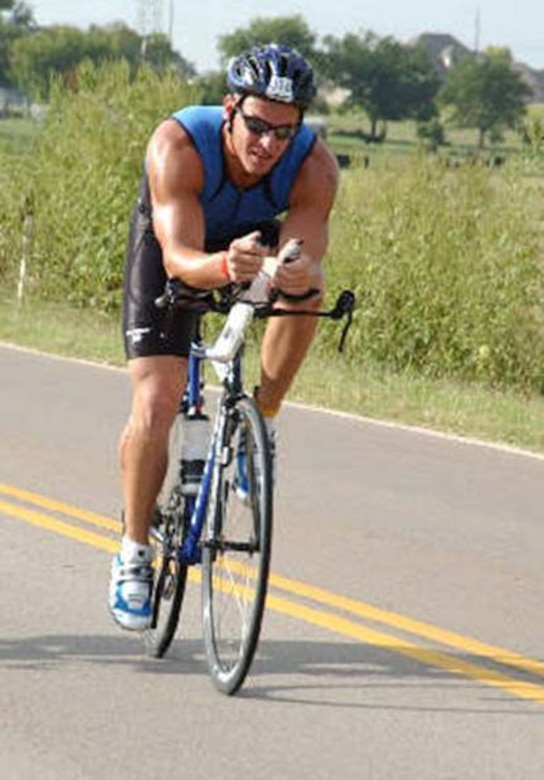 Capt. Robert Atkins rode the bike portion of the Half Iron Redman Triathlon, 56