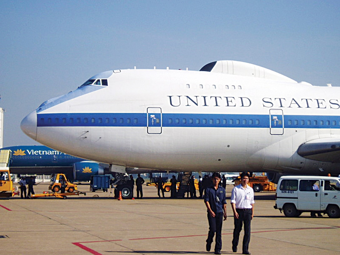 One of Offutt's E-4B National Airborne Operations Center aircraft sits on the tarmac in Vietnam. The 55th Wing aircraft was called on to lend a helping hand to the presidential transport aircraft, Air Force One, after it encountered some maintenance issues. The E-4B is a modified Boeing 747 whose mission is to provide support to the national leadership of the United States. Photo by Mark Silva/Chicago Tribune