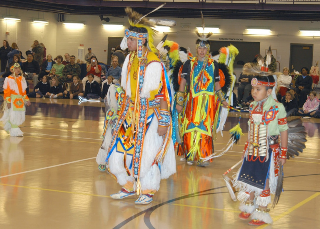 Members of the Winnebago Indian Tribes dance team, perform authentic Native American ceremonial dances at the Lied Activity Center in Bellevue, Neb., on Nov. 15, 2006.  The tribal dance performance was the highlight of the culture fair events, held as part of Native American Heritage Observance month.  (Air Force Photo by Daniel J. Rohan Jr.)