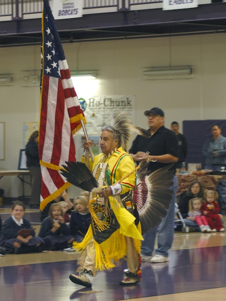 Richard Barea, a tribal dancer from the Omaha Tribe, leads the opening ceremonies with Old Glory in hand as part of the Native American Heritage Observance month culture fair held at the Lied Activity Center in Bellevue, Neb., on Nov. 15, 2006. (Air Force Photo by Daniel J. Rohan Jr.)