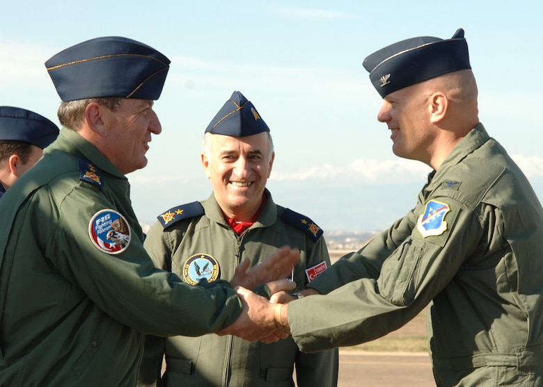 "Col.l Murrell ""Tip"" Stinnette, left, 39th Air Base Wing commander, and Brig. Gen. M. Yilmaz Erdogan, right, 10th Tanker Command commander, greet Maj. Gen. Sefer Ozturks on arrival Dec. 5. General Ozturks arrived with members of the U.S. and Turkish Defense Economic Cooperation Agreement teams. (U.S. Air Force photo by Airman Kelly L. LeGuillon)"