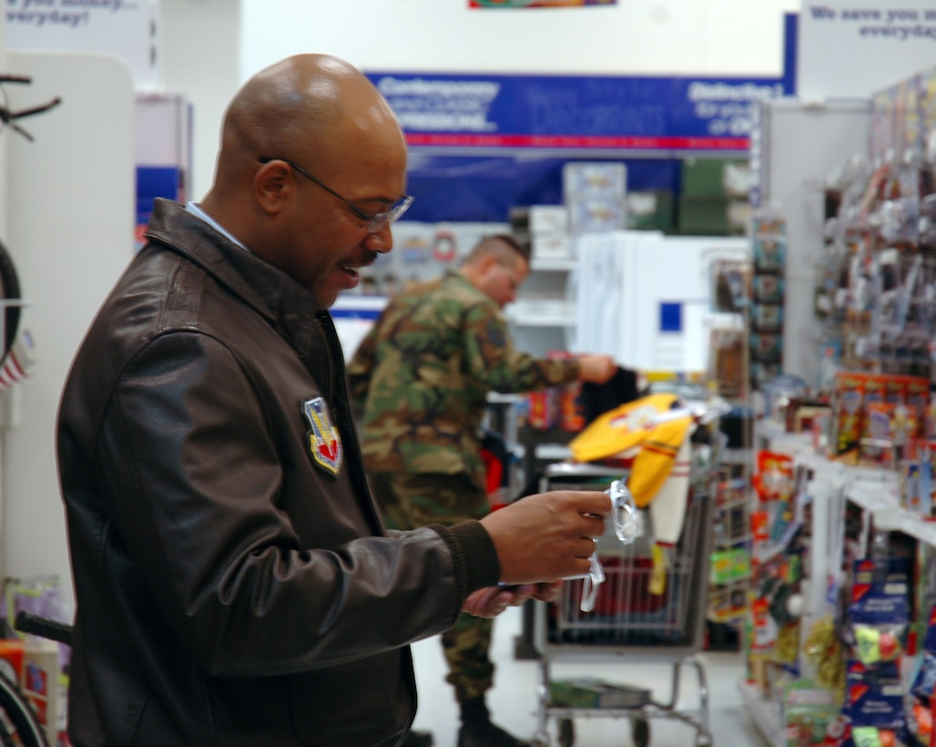 BUCKLEY AIR FORCE BASE, Colo. -- Master Sgt. Lee Frye, 566th Information Operations Squadron first sergeant, checks his tags from the Angel Tree to make sure he picks out the right gifts for the children he is shopping for. Team Buckley first sergeants and other volunteers spent approximately $4,600 donated by the Homefront Heroes Denver chapter, a non-profit military support group. The Angel Tree project provides family members of all services', E-5's and below, gifts for the holidays. (U.S. Air Force photo by Staff Sgt. Sanjay Allen)