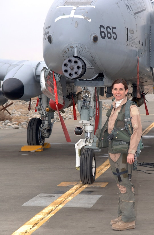 Lt. Col. Martha McSally stands with her A-10 Thunderbolt II aircraft. The colonel is the first female pilot in the Air Force to fly in combat and to serve as a squadron commander of a combat aviation squadron. (U.S. Air Force photo)