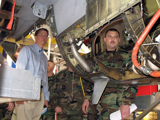 Master Sgt. Ben Carson shows Dr. Ron Ritter an F-16 Fighting Falcon. Dr. Ritter is the Secretary of the Air Force's special assistant for Air Force Smart Operations 21. He visited Aviano Nov. 29 to see firsthand what AFSO 21 improvements 31st Air Maintenance Squadron Airmen are making and how they are being implemented. Sergeant Carson is the 31st AMX inspection chief. (Photo by Staff Sgt.Matt Lichtenberg)