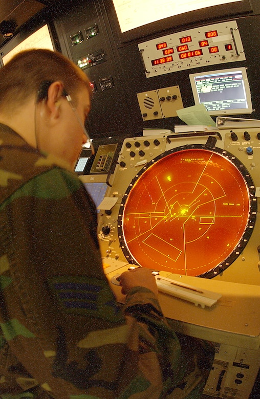 A radar and approach control center air traffic controller watchs the radar during his shift. RAPCON members take the hand-off from tower members to help an aircraft continue to its destination.  (Photo by Senior Airman Dallas Edwards)