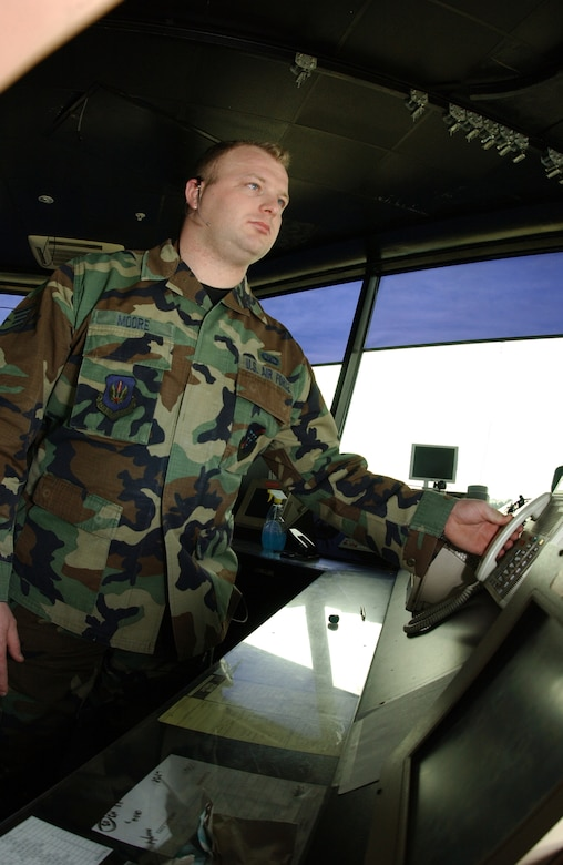 Staff Sgt Jeremiah Moore, 39th Operations Squadron air traffic controller, goes to answer the primary crash alaem system phone in the tower. Air traffic controllers have to be able to respond to any situation while in the tower. (Photo by Senior Airman Dallas Edwards)