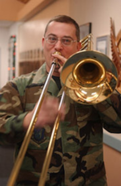 EIELSON AIR FORCE BASE, Alaska--Staff Sgt. William Harris, PACAF Alaska Brass Quintet trombone player, plays Christmas music Dec. 6 at the 355th Fighter Squadron. (U.S. Air Force photo by Senior Airman Anthony Nelson Jr.)
