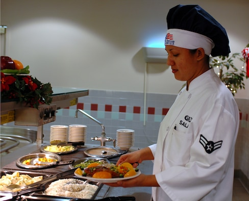 Airman 1st Class Irene Salas, 60th Services Squadron, serves lunch at the Sierra Inn Dining Facility Dec. 5. She was named an outstanding performer during the AMC Hennessy Award inspection in October. (U.S. Air Force photo by Tech. Sgt. Donald Osborn/ 60th Air Mobility Wing Public Affairs)
